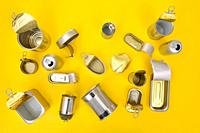 top view of a set of cans on yellow background.
