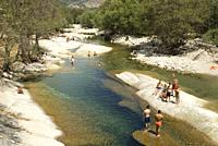 People swimming at Garganta de los Caballeros River, Gredos Mountains, Central Range, province of Avila, Castilla y Leon Region, Nava del Barco, Spain...