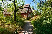 Traditional red wooden house in Sweden