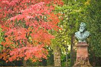 Statue of Victor Nessler in the Orangerie garden during autumn season in the city of Strasbourg