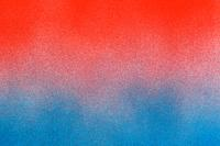. spray paint gradient from red to blue on a white paper background.