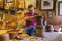 The artisan Pablo Tito in his traditional ceramic workshop. Alfareria Pablo & Paco Tito, Ubeda. Cordoba province, Andalusia, Southern Spain Europe.