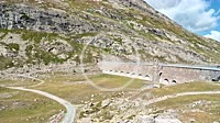 4K Dam wall in a mountain landscape at Lago Bianco, Bernina Pass in Spring, Switzerland