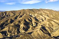 Bare ridges of eroded sandstone in the Tabernas Desert, Europe's only true desert. Aerial view. Drone shot. Almeria province, Andalusia, Spain.