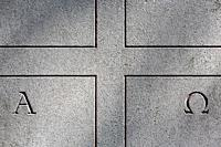 Stone cross on a gravestone. Alpha. Omega. Pere Lachaise cemetery. Paris. Ile-de-France. France. Europe.