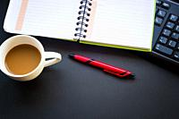 diary with coffee cup and pen.