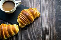 Croissant Brioche with a taza de cafe.