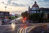 Yangon, Republic of the Union of Myanmar, Asia - An elevated view of the daily evening rush hour traffic along Strand Road and the British colonial bu...