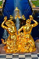 Golden sculptures the Triton's fountain. Architect I.Prokofiev. Grand Cascade. Peterhof Petrodvorets Russia