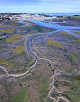 Aerial view at low tide of the Rio del Escudo and Marisma de Rubin, Oyambre Natural Park, San Vicente de la Barquera, Cantabrian Sea, Cantabria, Spain...