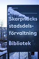 Stockholm, Sweden A sign for the Skarpnack district administration offices and library.
