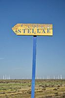 A sign of the Way to Santiago de Madrid as it passes through the province of Valladolid that reads Campus Stellae. The wind turbine fields of the Mont...