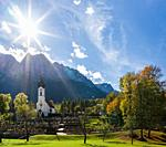 Church St. Johannes der Taeufer (John the Baptist), Mount Zugspitze in the background. Village Grainau near Garmisch-Partenkirchen and mount Zugspitze...