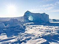Icebergs frozen into the sea ice of the Uummannaq fjord system during winter in the the north west of Greenland, far beyond the polar circle. North Am...