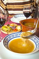 Serving cocido soup. Madrid, Spain.