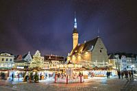 Tallinn, Estonia. Night Stars Sky Above Traditional Christmas Market And Carousel On Town Hall Square. Christmas Tree. Famous Landmark. Altered Starry...