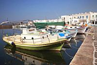 Traditional fishing boats at Naoussa port, Paros Island, Cyclades Islands, Greek Islands, Greece, Europe.