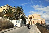 Motorcyclist in front of the Venice-style waterfront houses, Ermoupolis, Syros Island, Cyclades Islands, Greek Islands, Greece, Europe.