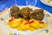 Oxtail with potatoes and red peppers. Spain.