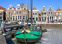 view at harbour of Blokzijl with frozen water in wintertime, Holland