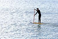athlete in paddle surf in front of the beaches of Barcelona, Catalonia, Spain