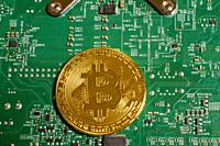 Bitcoin close-up on a computer motherboard.