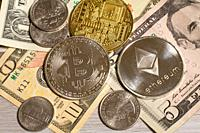 Close-up of cryptocurrency and United States currency.