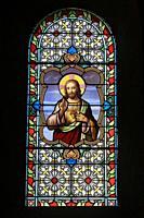 The Sacred Heart of Jesus. Stained glass window. Saint-Nicolas Church. Combloux. Haute-Savoie. Auvergne Rhône-Alpes. France. Europe.