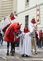 The town criers travel the city of Valladolid on horseback during the proclamation of the Sermon of the Seven Words. Door of the Colegio de San Gregor...