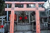 Kyoto, Japan, Asia - Stone figures depict Inari Okami, the Japanese fox (Kitsune), deity (Kami) on Mount Inariyama where the Fushimi Inari Taisha, a S...
