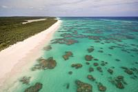 Aerial view of the dotted coral formations along the Atlantic Ocean side of Cat Island, Bahamas.