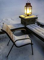 Frozen summer patio in winter at twilight.