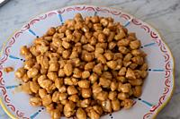 Struffoli - Traditional Neapolitan Dessert made from eggs, flour, Marsala wine and sugar. Served at Christmas. Honey Glazed, Fried.