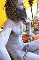 naga baba on the ghats of benares, one of the favorite performances of the Nagas demonstrating its power of renouncing all sexual forms, awaiting the ...
