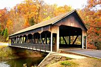 Fall colors with a wooden bridge at Mohican State Park in northern Ohio OH.