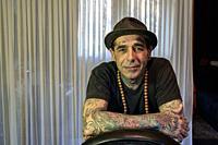Tilburg, Netherlands. Portrait of Tatoist Dave Plu inside his Tattoo Art Studio.
