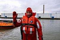 Rotterdam, Netherlands. Russian SeaMan in a suit thet prevents him form cold and drowning during an emergancy procedure training.