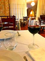 Glass of red wine in a restaurant.
