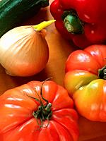 Tomatoes, onion, red pepper and courgette. Still life.