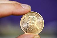 Close up of a Krugerrand, South African gold coin.