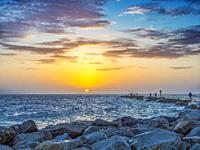 Colorful yellow orange , orange sunset over the Gulf of Mexico at the South Jetty in Venice Florida USA.
