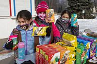 New Baltimore, Michigan - Girl Scouts brave frigid temperatures to sell cookies along a Michigan highway.