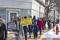Grosse Pointe Park, Michigan - Several hundred people marched past the home of Je Donna Dinges to protest hate and racism in their historically white ...