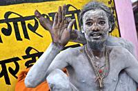 naga baba yogi, on the benares ghats awaiting the shivaratri which will close the kumbh mela of Allahabad, UP, india.