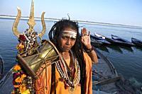 laxmi giri sadhu woman with the trident on the ghats of benares a few days before the shivaratri. benares, UP, india.