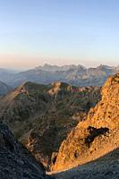 Warm sunrise at Pyrenees mountain range, border between France and Spain. Orange and teal colors are the main on this picture.