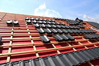 Roofing work, new covering of a tiled roof.