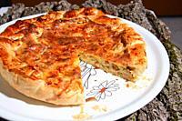 savory pie stuffed with ham mozzarella cheese.