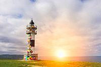 Famous lighthouse in the sunset painted by the painter Okuda, located in Ajo, Cantabria, Spain.