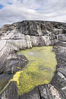 Small pond in a rocky formation along the Atlantic Road in Norway.